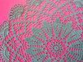 Blue crochet serviette on pink background Royalty Free Stock Photos