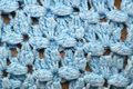 Blue crocheted afghan blanket detail a detailed close up of fills the frame of this image making it suitable for knitting Royalty Free Stock Image