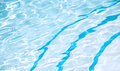 Blue crystal clear pool with curved steps Royalty Free Stock Photo