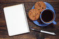 Blue cup of coffee, cookies and notepad Royalty Free Stock Photo