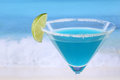 Blue curacao cocktail on the beach with copyspace while vacation Royalty Free Stock Image
