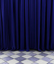 Blue curtain a over a diamond shaped checkerboard floor Royalty Free Stock Photo