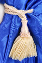 Blue curtain with tassel close up of the Royalty Free Stock Image