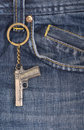 The blue denim jeans with a gun Royalty Free Stock Photo