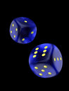 Blue dice two isolated over black background with clipping path Royalty Free Stock Image