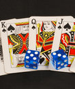 Blue dices on poker cards Stock Photos