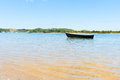 Blue dinghy afloat on peaceful calm Ngunguru estuary Northland N Royalty Free Stock Photo
