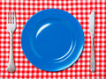 Blue dinner plate with fork and knife Stock Images
