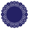 Blue doily lace round royal Arkivfoton
