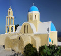 Blue dome church santorini island with and bell tower in the village of oia on greece Stock Images
