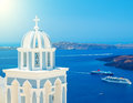 Blue dome of famous church in Santorini with view on the caldera and cruise ships Royalty Free Stock Photo