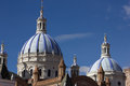 Blue domed cathedral spires ecuador set against a sky in Stock Photo