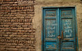 Blue door with Arabic writing, Luxor town, Egypt Stock Image