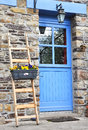 Blue door came Stock Photography