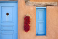 Blue door chili pepper ristra adobe house new mexico Stock Photos