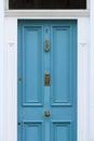 Blue door gates and doors in bray wicklow ireland Royalty Free Stock Image
