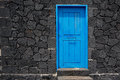 Blue door lava stone masonry wall at La Palma Royalty Free Stock Photography