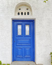 Blue door of a Mediterranean island house Stock Image
