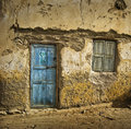 Blue door on mud-brick house Stock Images