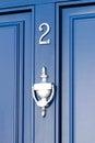 Blue door number gates and doors in bray wicklow ireland Stock Photo