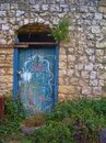 Blue door and stone wall in Rosh Pina Israel Royalty Free Stock Photo
