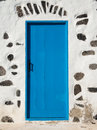Blue door in white house a at the entrance to a walled cottage pozo negro lanzarote canary islands Royalty Free Stock Photography