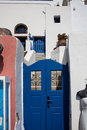 Blue doors in the greek village of ola santorini Stock Images