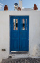 Blue doors in the greek village of ola santorini Royalty Free Stock Images