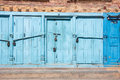 Blue doors locked with padlocks Royalty Free Stock Image