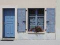 Blue doorway and shuttered window study of Stock Photos