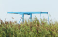 Blue drawbridge hidden in the reeds Stock Photo