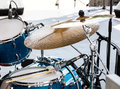 Blue drum set with two wooden drumsticks on it. musical instrume