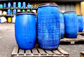 Blue drums plastic chemical in a chemical storage Royalty Free Stock Photo