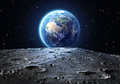 Blue earth seen from the moon surface Royalty Free Stock Photo