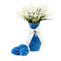 Blue easter decorations on white background eggs painted and spring flowers in matching vase Stock Image