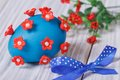 Blue easter egg decorated with red flowers with bow Royalty Free Stock Photos