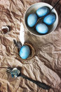 Blue easter eggs on a paper background rustic style painted with hibiscus Stock Photos