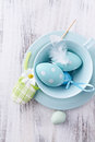 Blue easter eggs in a tea cup dotted ceramic Stock Image