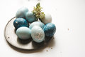 Blue Easter eggs on tin plate, decorated with flowers Royalty Free Stock Photo
