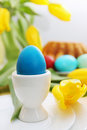 Blue egg passover holiday still life eggs flowers and cake Royalty Free Stock Photos