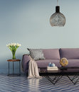 Blue elegant purple sofa with a side table and flowers Royalty Free Stock Photo