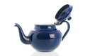Blue ename tea pot open isolated over white background Royalty Free Stock Images