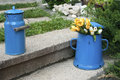 Blue enamel jugs on stone steps retro metal old in back yard house garden Stock Photography