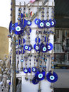 Blue evil eye charms sold at market in turkey Stock Image