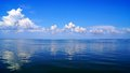 Blue expanse of the sea and blue sky with clouds Stock Photo
