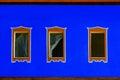 Blue exterior with three windows Royalty Free Stock Photo