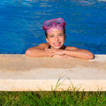 Blue eye kid girl on on blue pool poolside smiling Stock Images