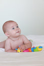 Blue eyed baby looking up, naked Royalty Free Stock Photo