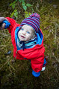 Blue-eyed baby outdoors, autumn season.8months old Stock Photography