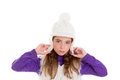 Blue eyes child kid girl with white winter cap fur Royalty Free Stock Image